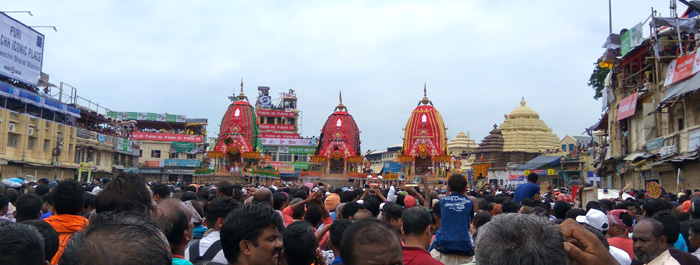 Three colorful Chariots parked at Lion's Gate