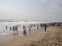 Devotees taking holy bath at Puri Beach